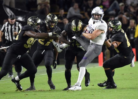 The Purdue defense surrounds Northwestern wide receiver Flynn Nagel in the second half Thursday, August 30, 2018, at Ross-Ade Stadium. Purdue fell to Northwestern 31-27.