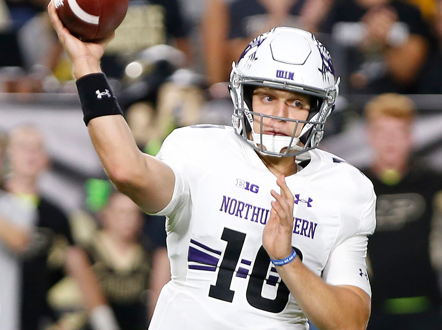 Northwestern quarterback TJ Green with a pass against Purdue in the first quarter Thursday, August 30, 2018, in West Lafayette.
