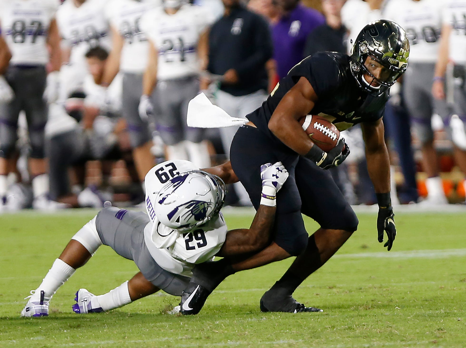 Jared Sparks of Purdue tries to shake off Greg Newsome II of Northwestern after a pass reception Thursday, August 30, 2018, in West Lafayette. Northwestern defeated Purdue 31-27.