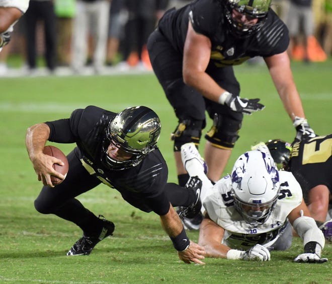 Quarterback David Blough lunges for a first down in the third quarter against Northwestern Thursday, August 30, 2018, at Ross-Ade Stadium. Purdue lost to Northwestern 31-27.