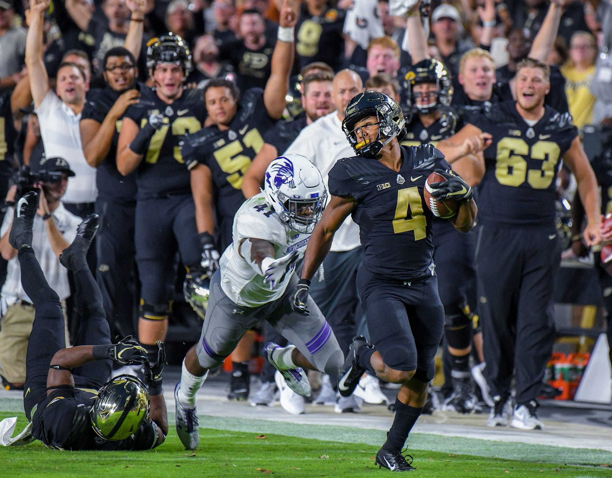 Purdue's Rondale Moore runs 76 yards for a touchdown, part of his record-breaking 313 all-purpose yards Thursday night against Northwestern.