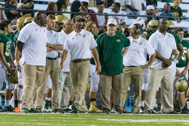 New Acadiana High head coach Matt McCullough, shown here pacing the sidelines of the jamboree with headsets on, will be making his regular-season debut as the Rams' new coach Friday at Kaplan.