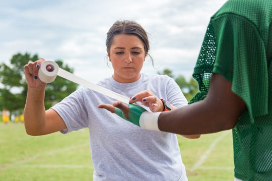 While the main focus of Kathryn Resweber's job as an athletic trainer is the health of the athlete, it doesn't end there.