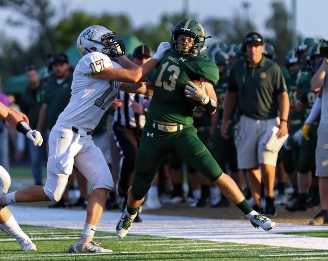 Howell's John Trochio is forced out of bounds by Plymouth's Preston Long in the Highlanders' 26-17 loss on Thursday, Aug. 30, 2018.