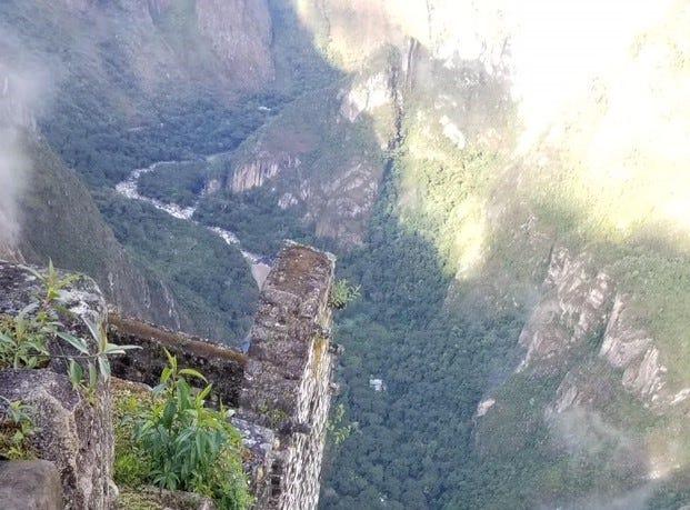 Kirby Adams climbing the steps of Huayna Picchu