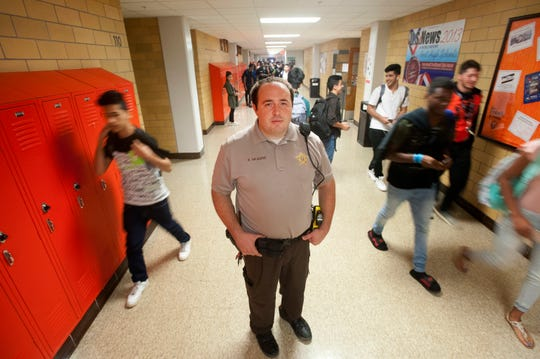 Fern Creek High School Resource Officer Robbie Skaggs is a Jefferson County deputy sheriff. Here he stands in the hallway next to the cafeteria during the break between 3rd and 4th periods.August 31, 2018