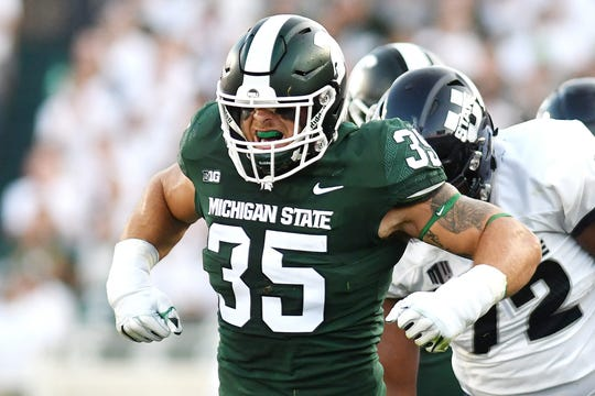 Michigan State's Joe Bachie celebrates after a stop for a loss during the first quarter on Friday, Aug. 31, 2018, at Spartan Stadium in East Lansing.
