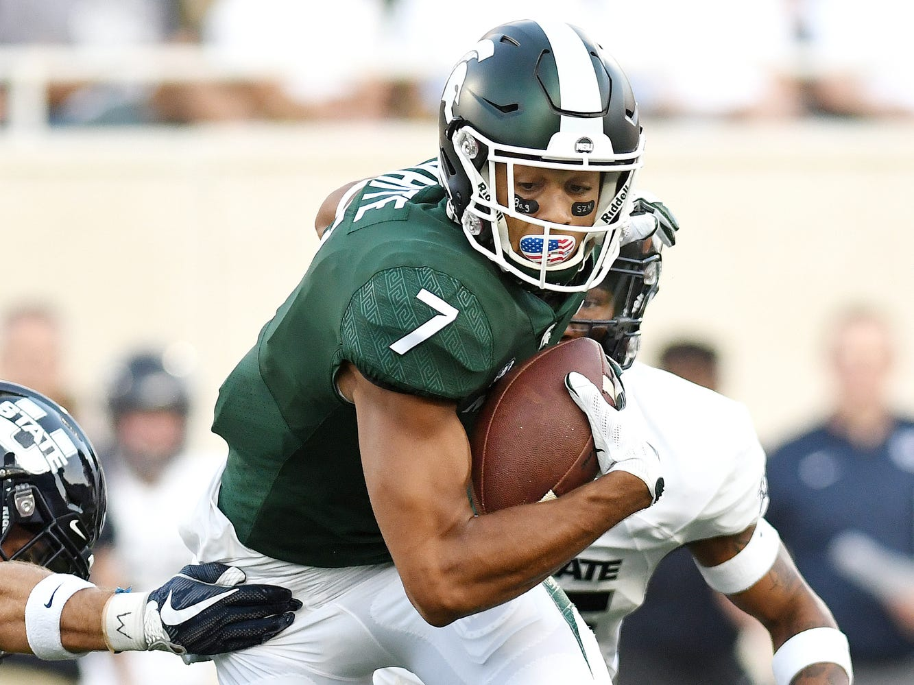 Michigan State's Cody White catches a pass during the first quarter on Friday, Aug. 31, 2018, at Spartan Stadium in East Lansing.