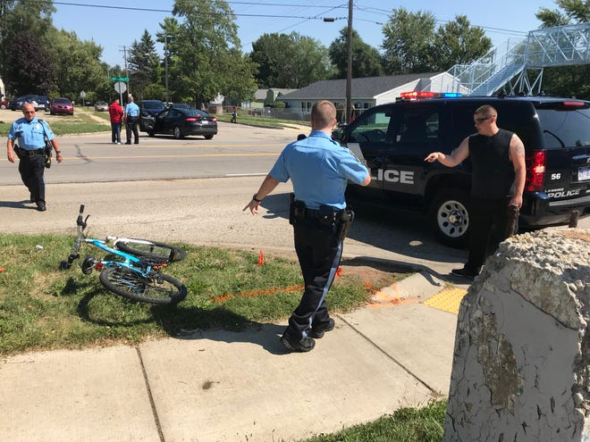 Lansing police said an 11-year-old girl was struck by a car at Martin Luther King, Jr. Boulevard and Reo Road in Lansing on Friday.