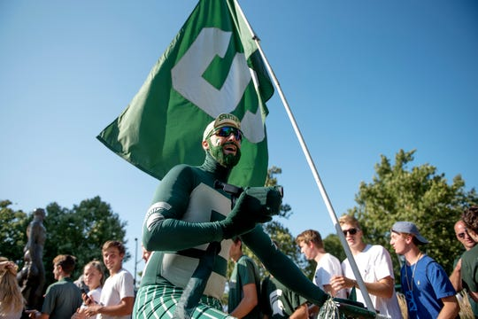 Johnny Spirit gets fans cheering before the Spartans' game against Utah State on Friday, Aug. 31, 2018, in East Lansing.