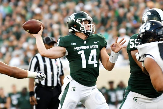 Michigan State's Brian Lewerke throws a pass during the first quarter on Friday, Aug. 31, 2018, at Spartan Stadium in East Lansing.