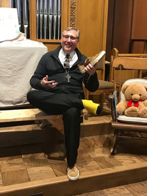 The Rev. Dr. Matthew L. Sauer dressed as Mister Rogers.