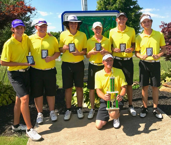 The Lexington Minutemen, led by coach Greg Smith (front) and team medalist Nick Stehle (second from right) won Friday's McLean Invitational for their fourth tournament title this season.
