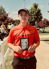Ashland's Max Watson with his medalist plaque after shooting a four-under-68 in Friday's McLean Invitational.
