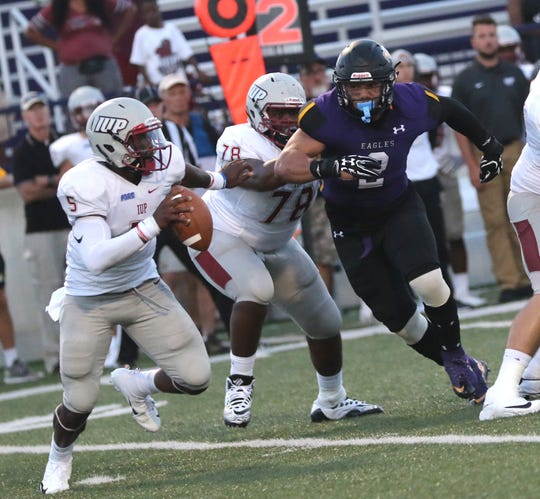 Ashland defense end James Prater Jr. tries to chase down IUP quarterback Lenny Williams