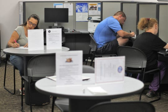 Marion County residents look for jobs in August 2018 at Ohio Means Jobs' Marion office on Leader Street. The jobless rate in Marion County hits its lowest level in decades in April.