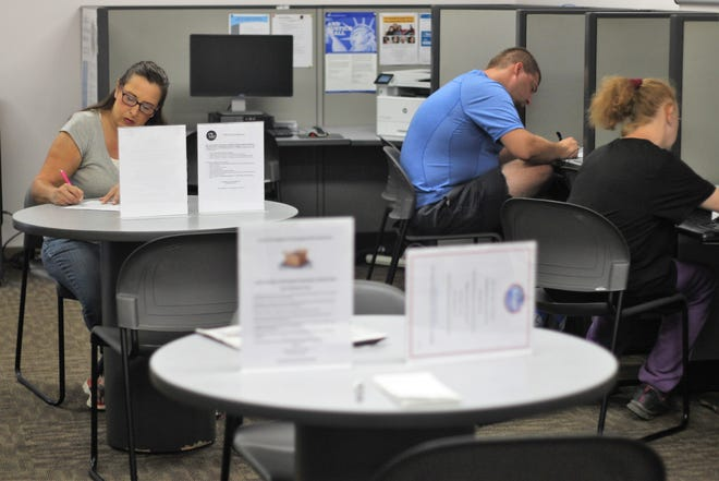 Marion county residents look for jobs at Ohio Means Jobs' Marion office, 622 Leader St., on Tuesday.  According to the agency's website, around 500 jobs are available in the county as the area's unemployment rate dips below 5 percent.
