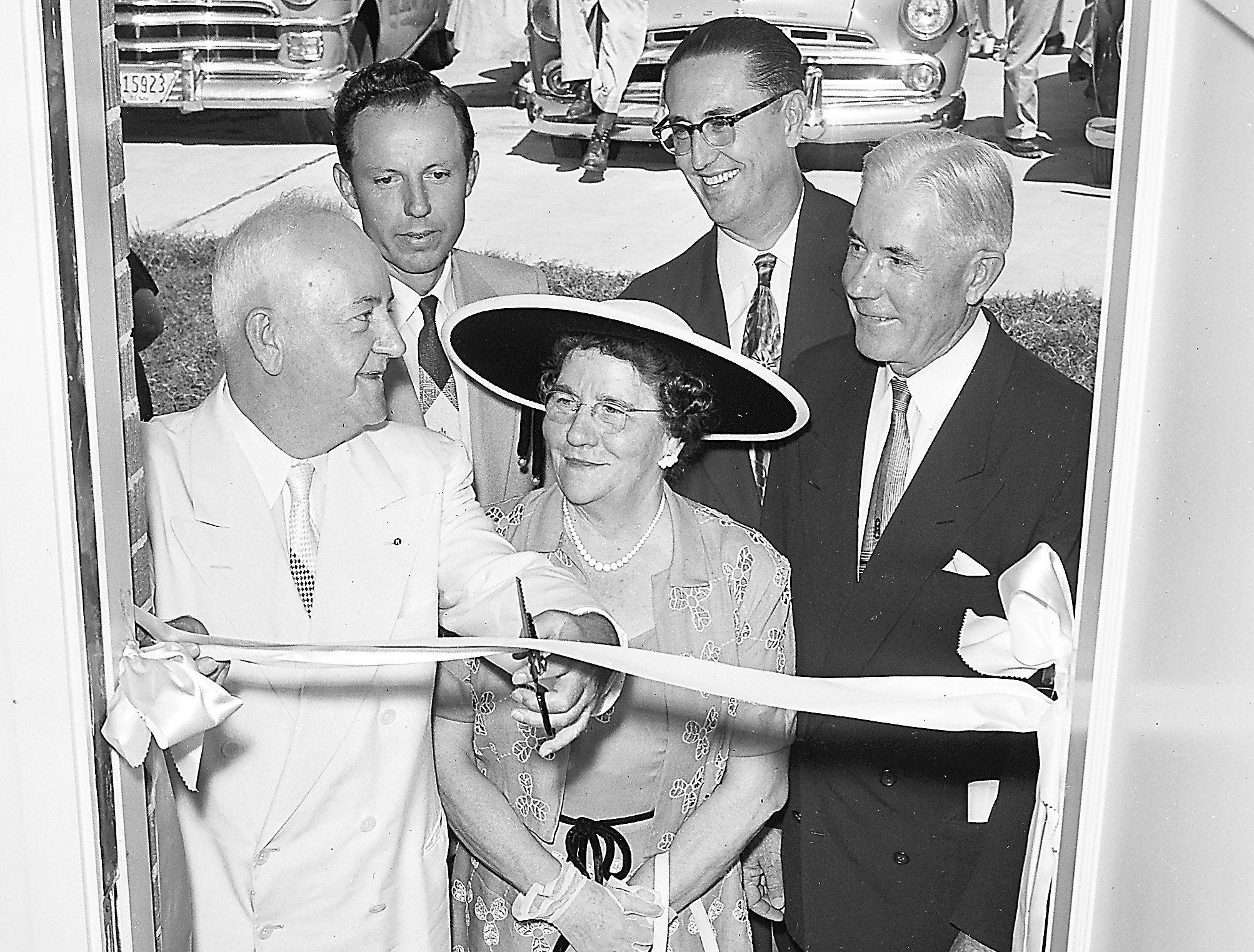 Removing the last barrier standing between 450 families and shining new homes, Mayor Frank Tobey, left, cut the satin ribbon tied across the entrance to one of the apartments at the Dr. H.P. Hurt village in official ceremonies in August 1953. Watching the ribbon-cutting, which also began a week-long open house at the Jackson and Thomas development were Charles D. Akers Jr., second left, president of the Memphis Retail Furniture Dealers Association; Mrs. H.P. Hurt, widow of the Baptist minister for whom the village was named; Orelle L. Ledbetter, second right, assistant housing director for management of the Memphis Housing Authority and Dr. L.M. Graves, MHA vice chairman.