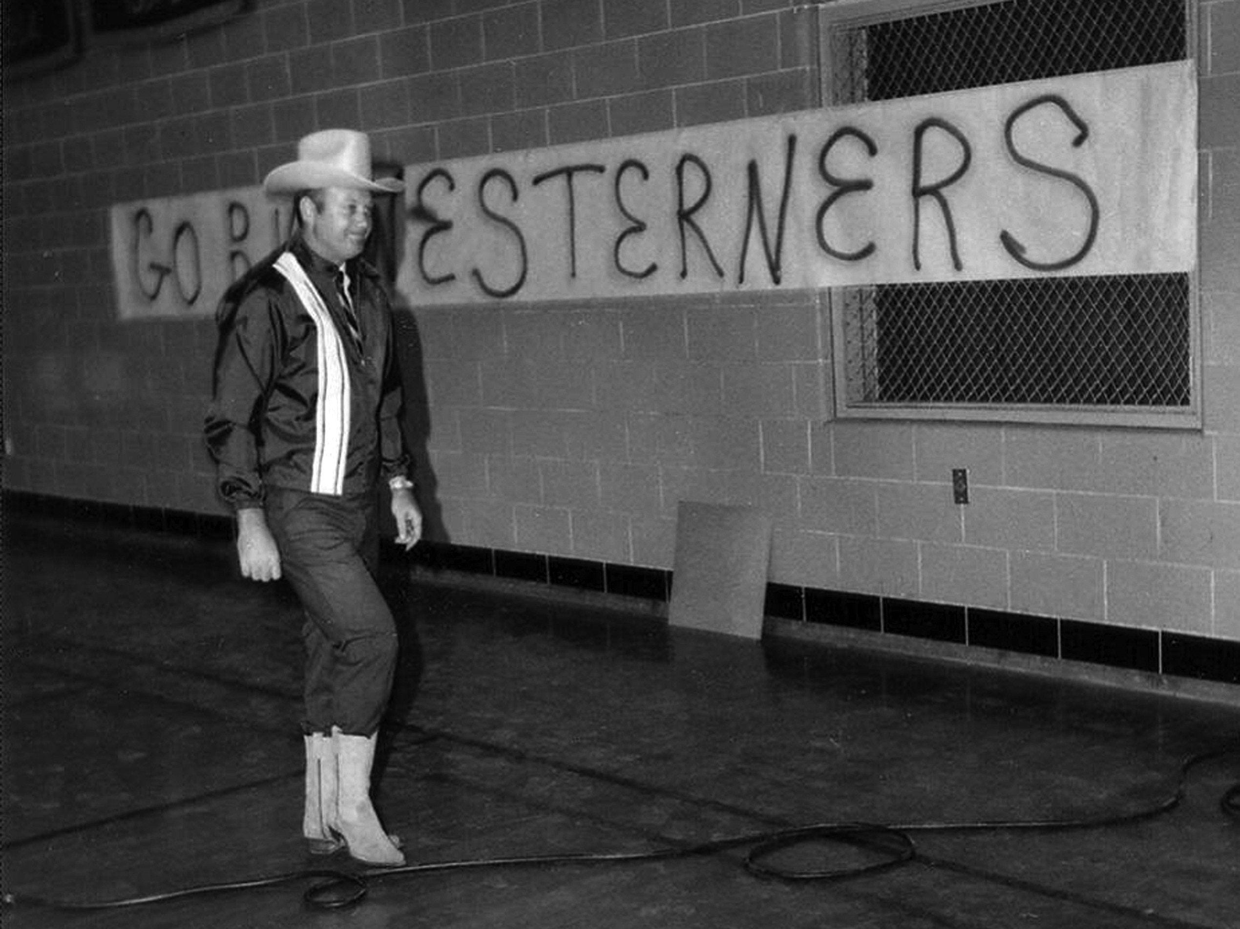 """In September 1970, Pete M. Meadows made an entrance to his first assembly program as the new Principal of Westwood High School.  With the """"Go Westerners"""" banner in the background, Mr. Meadows received a standing ovation from the students as he entered the gymnasium wearing jeans, cowboy hat & boots!  If you'd like to touch base with the former coach and principal, you can contact him at: Pete M. Meadows; 2549 Strathspey Cove; Memphis, TN 38119."""