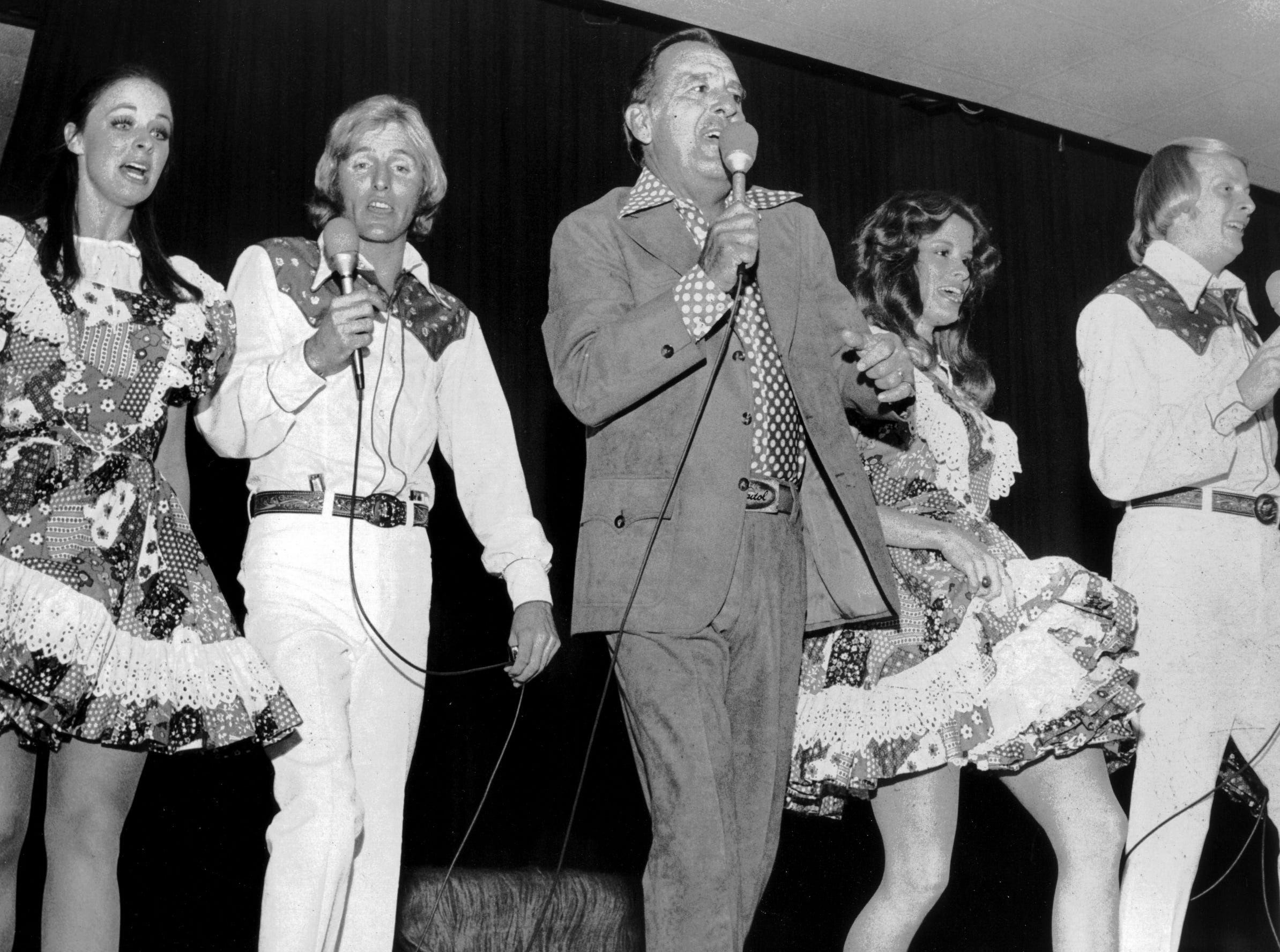 """Tennessee Ernie Ford (center) and his Nashville-Opryland touring troupe --- also dubbed the """"Moscow-Nashville Express"""" after a recent goodwill tour of the Soviet Union --- launched the 19th annual Holiday Inn World Conference at Holiday Inn-Rivermont on Oct. 20, 1974. Several hundred Holiday Inn officials and franchise owners from 43 countries and territories attended the show."""