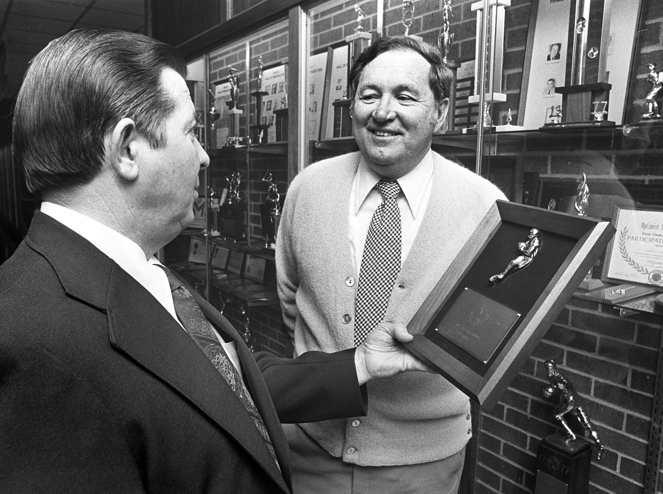 Gil Gideon (left), executive secretary of the Tennessee Secondary Schools Athletic Association (TSSAA), presented Christian Brothers High School football coach Tom Nix with a plaque on March 29, 1978, for CBHS' winning the Class AAA state football title in the fall of 1977. Other Memphis area coaches receiving state champion coaches plaques are Joe Branch (Bolton Class A boys basketball), Dorsey Sims (Melrose Class AAA boys basketball) and Ronn Rubio (Harding cross country).
