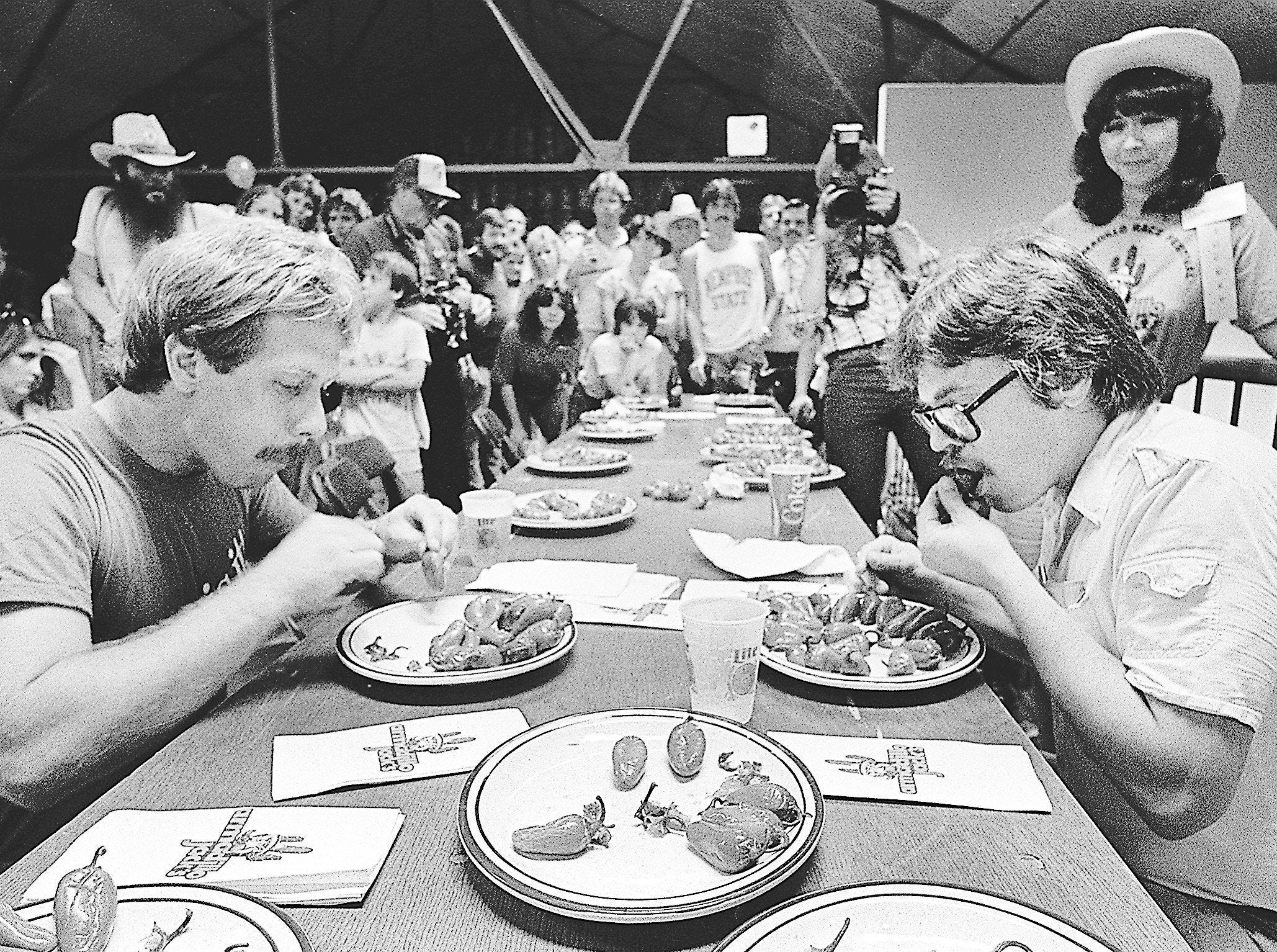 Steve Francomacaro, left, and Jim Inman, who tied for the lead in the Jalapeno Pepper Eating Contest at Beale Street Landing by downing 25 peppers in one minute, square off in a 15-second tiebreaker. Francomacaro snatched the victory on 7 July 1984 in tallying more than 30 peppers in the complete 75 seconds.