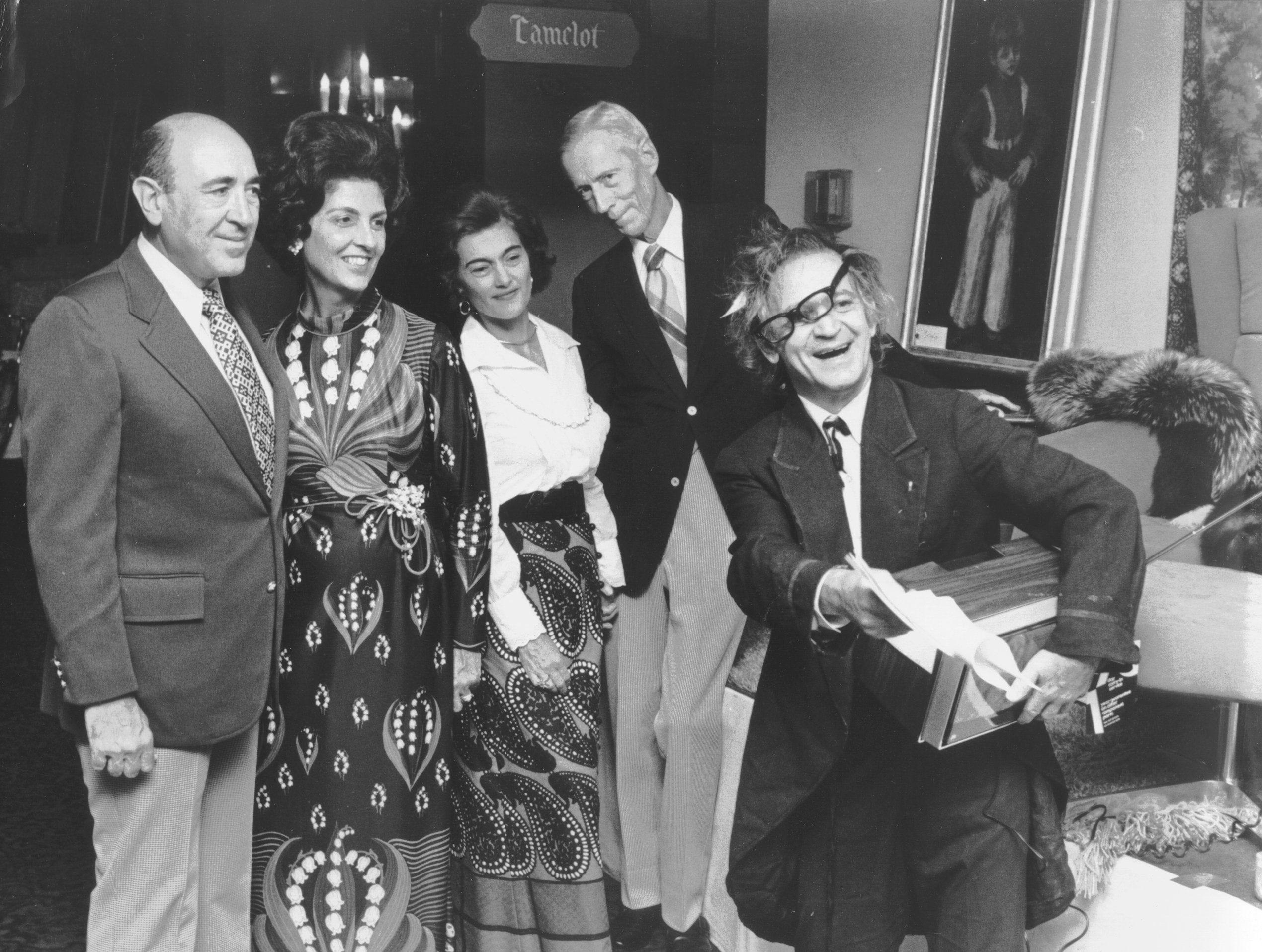 """Professor Irwin Corey (Right), self-styled """"world's foremost authority,"""" wowed them in Sep 1973 at """"Auction Fantastic,"""" a benefit for the American Cancer Society at Holiday Hall of Holiday Inn-Rivermont.  Watching him warm up for the sale (which included a riverboat trip to Baton Rouge, an ensemble designed by Michael Novrese, a year's supply of bacon and a tour of Spain) are (From Left) Mr. and Mrs. Leonard Pierotti and Mr. and Mrs. William Faye.  Tony Barrasso presented music at the party, which included cocktails and dinner and a silent auction before the major event."""