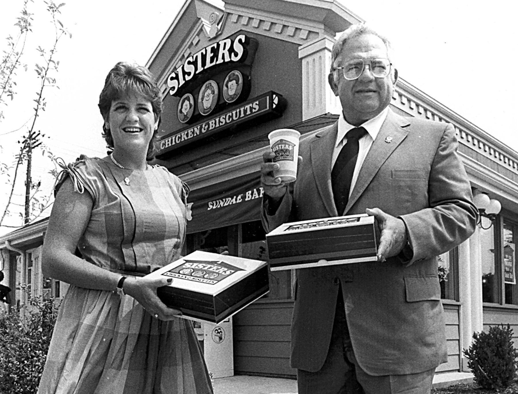 Fast food entrepreneur Dave Thomas (Right) and his daughter stand before Thomas' Sisters Chicken & Biscuits on Crump Blvd. on 10 Aug 1983.  Thomas later got out of the chicken business and opened a chain of hamburger restaurants which he named for his daughter, Wendy (Left).