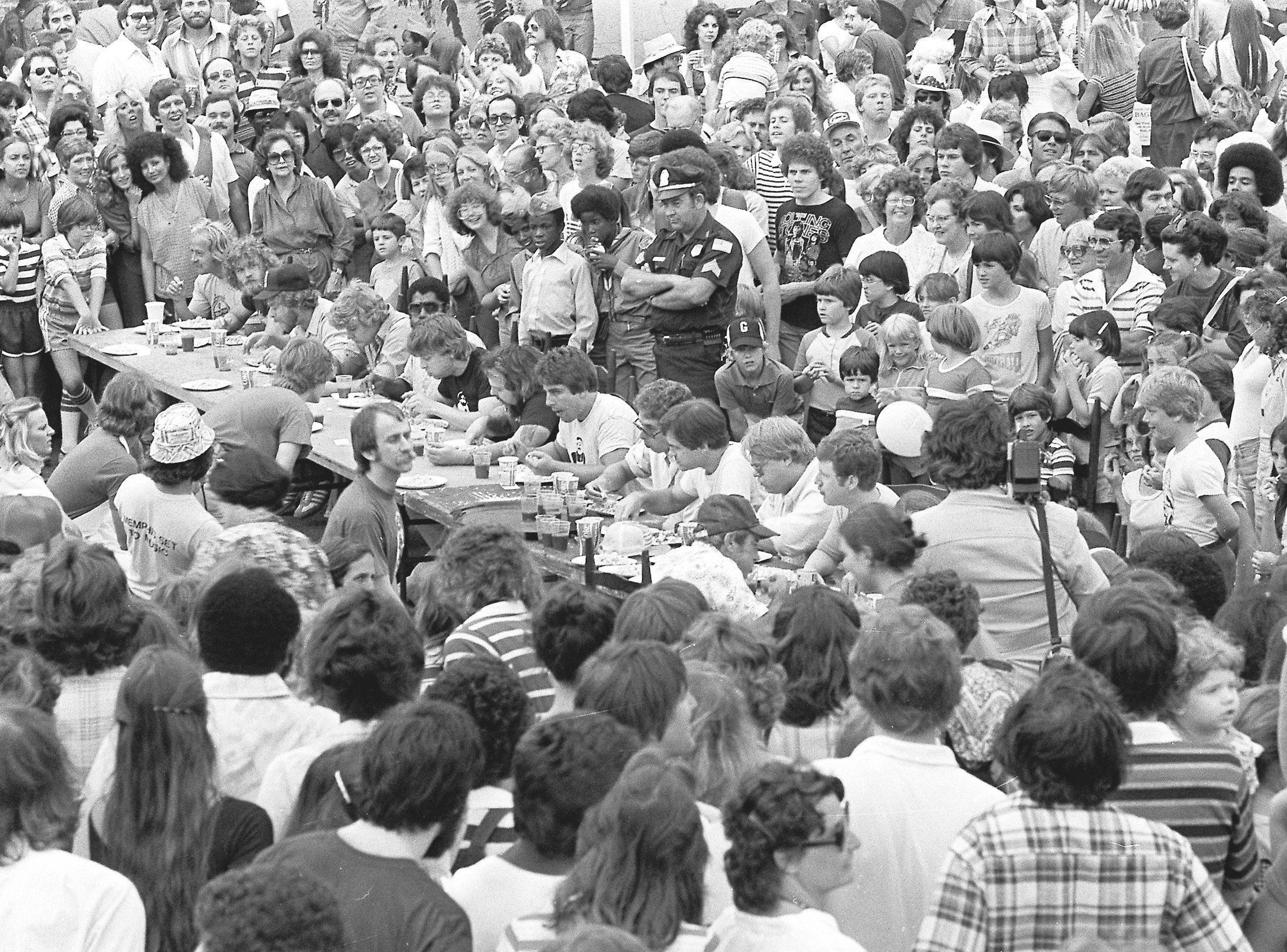 """J.W. """"Bear"""" Street, the bearded man wearing the dark shirt seated at the center of the table, set a world record for shrimp eating during the Beale Street Landing's Antique Sale and Oyster Festival in June 1979. Street paid $10 for 2 1/2 pounds of peeled shrimp, then set out with about 15 other paying contestants to beat the record of 7 minutes, 32 seconds in the Guinness Book of World Records. Street consumed his shrimp in 6 1/2 minutes and won $100, which he donated to St. Jude Children's Research Hospital. An estimated 35,000 persons attended the two-day festival. The event was sponsored by Beale Street Landing and QUAD-104 FM radio station."""