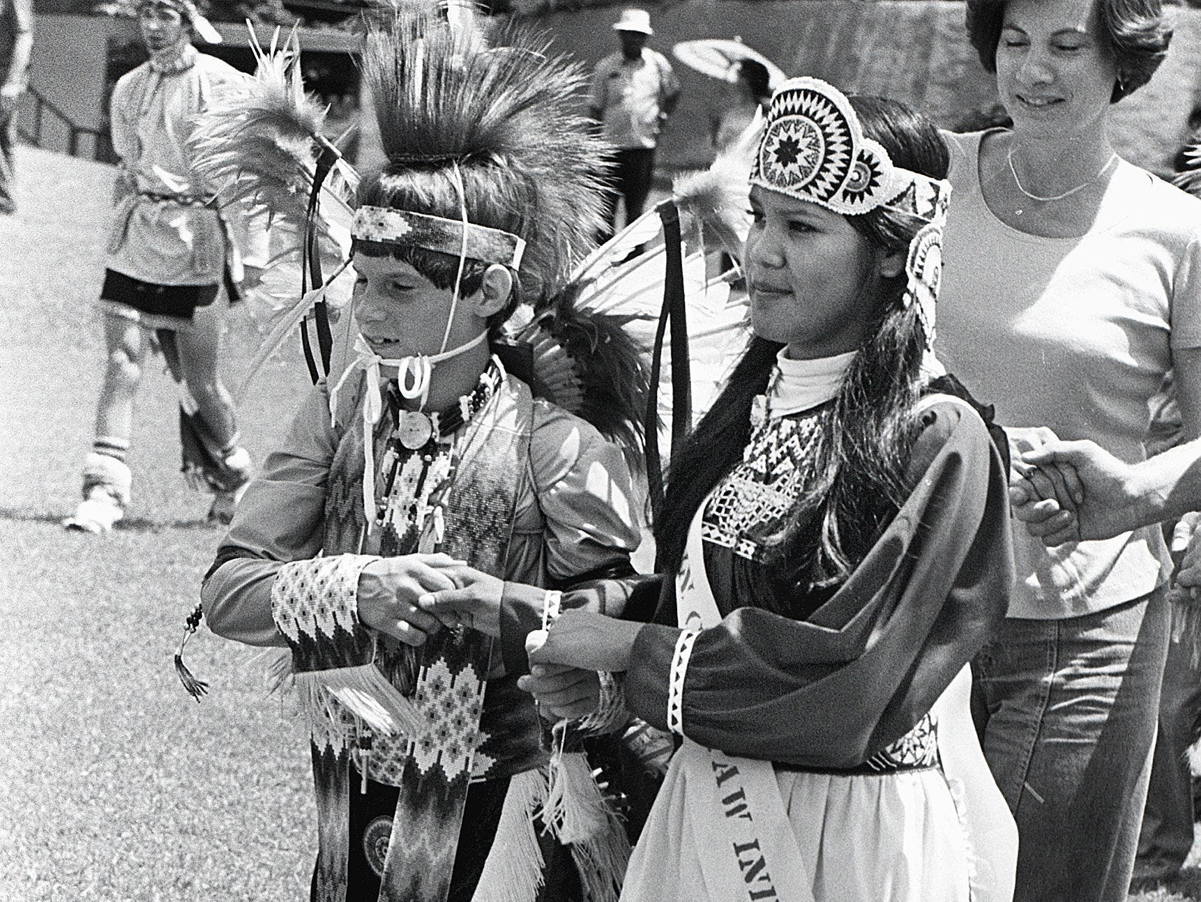 Billy Hooper, 13, was the escort of Sheri Ann Robinson, 17, the newly crowned 1978-79 Choctaw Indian Princess. Miss Robinson was selected on 4 Aug 1979 during the West Tennessee Choctaw Indian Powwow at Chucalissa Indian Village. The powwow features an exhibition of traditional Choctaw village life, with emphasis on music, dance and games.