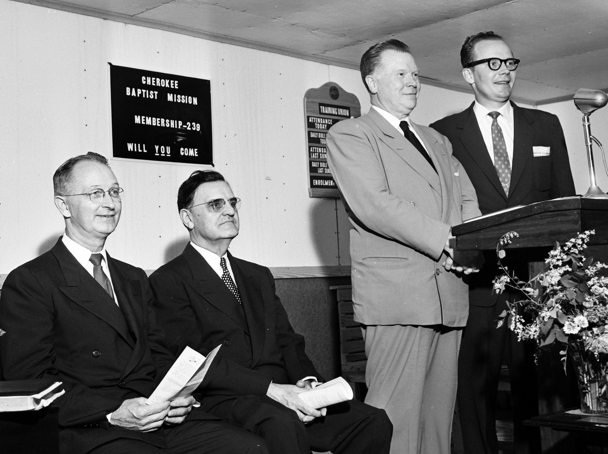The Rev. Mack R. Douglas, right, pastor of Cherokee Baptist Church, wore a smile with a reason in May 1953 ? his pastorate becomes a church instead of a mission after transfer of deed to the land at 3311 Kimball was made by Union Avenue Baptist Church. Jesse Daniel, left, State Baptist Sunday School secretary, and Dr. J.G. Hughes, second left, pastor of Union Avenue Baptist Church, took part in ceremonies, at which Dr. Harold E. Ingraham, second right, business manager of the Baptist Sunday School Board in Nashville, was speaker.