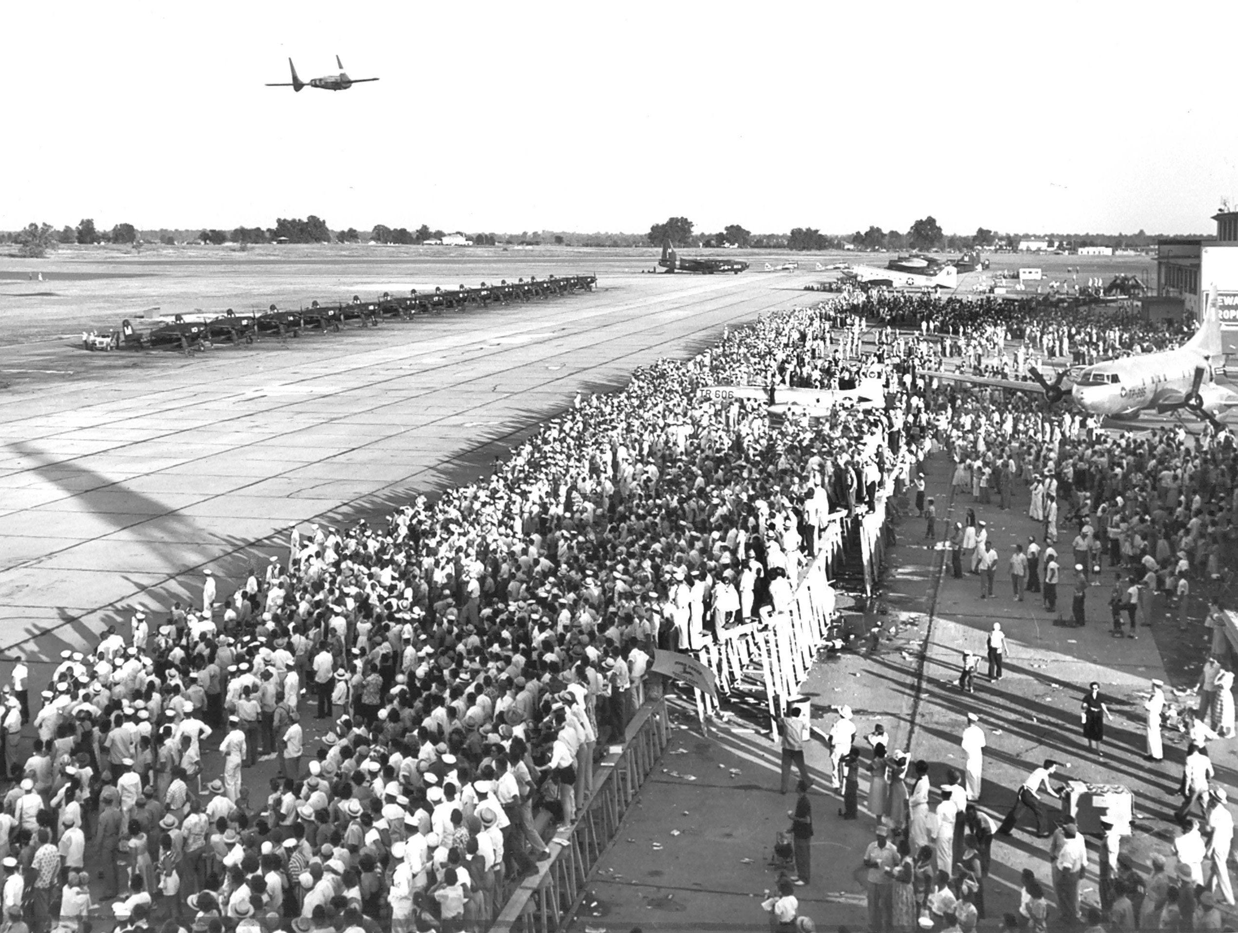 This is part of the crowd of 50,000 people who moved into Memphis Naval Air Station on 21 Jun 1953 for the festival finale. Navy officials estimated 100,000 people shared in the charity festivities.