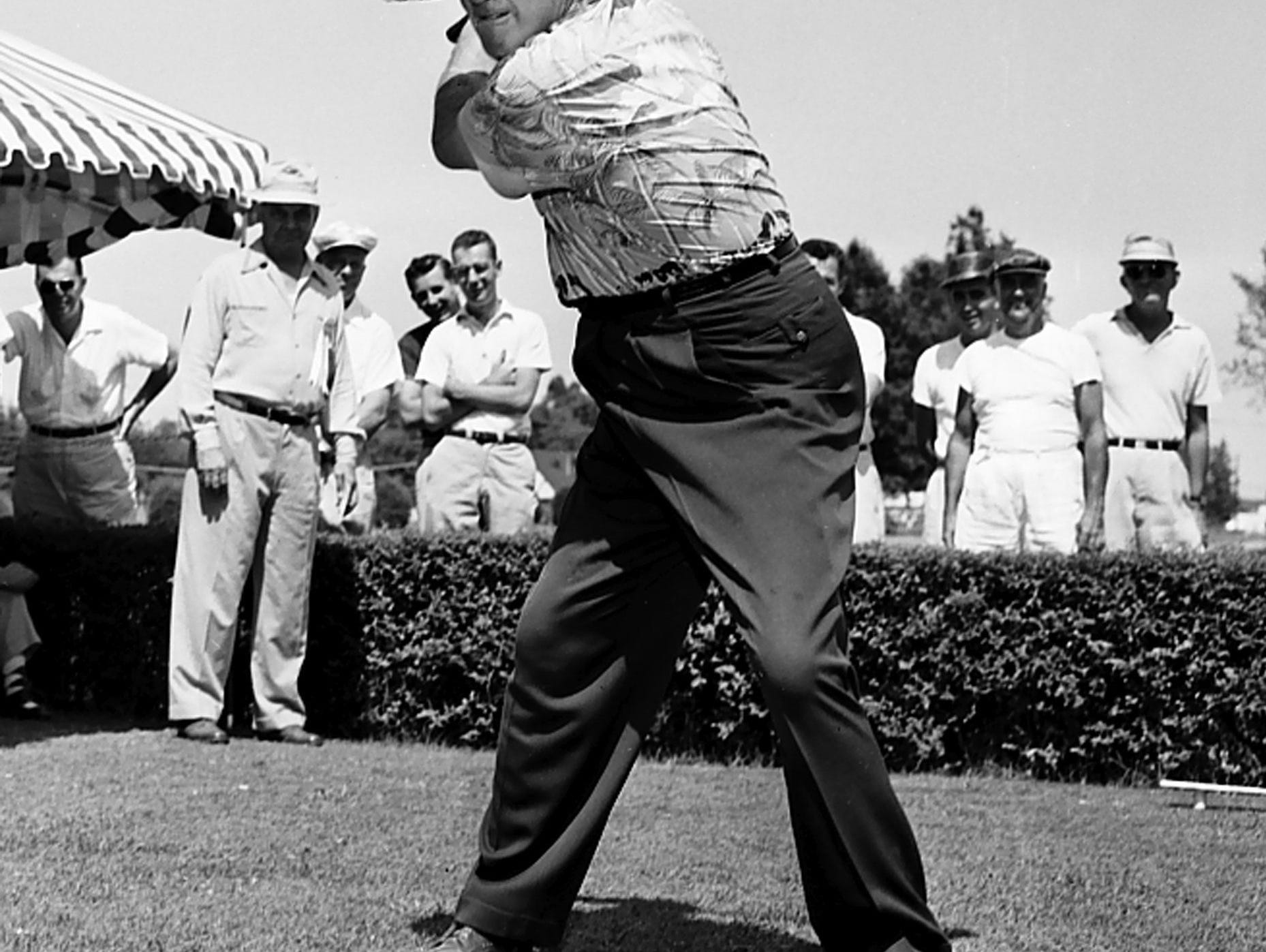 Hall of Fame baseball player and broadcaster Dizzy Dean, dressed quite appropriately, winds up for a three-club pitch at Colonial Country Club in July 1953. He was in Memphis for the Colonial Invitational golf tournament.