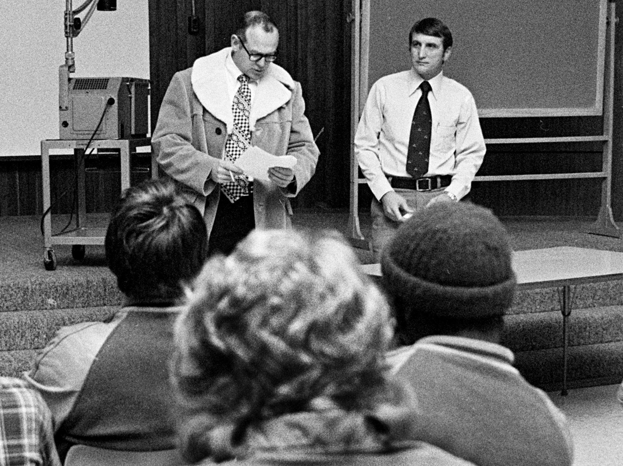 New Memphis State University head football coach Richardson Williamson (Right) meets the Tigers on 20 Jan 1975. At left is assistant coach Murray Armstrong. Williamson joins the Tigers after serving as receivers coach for Frank Broyles at the University of Arkansas for five years. Prior to that, he spent seven years as an aide to Bear Bryant at Alabama.