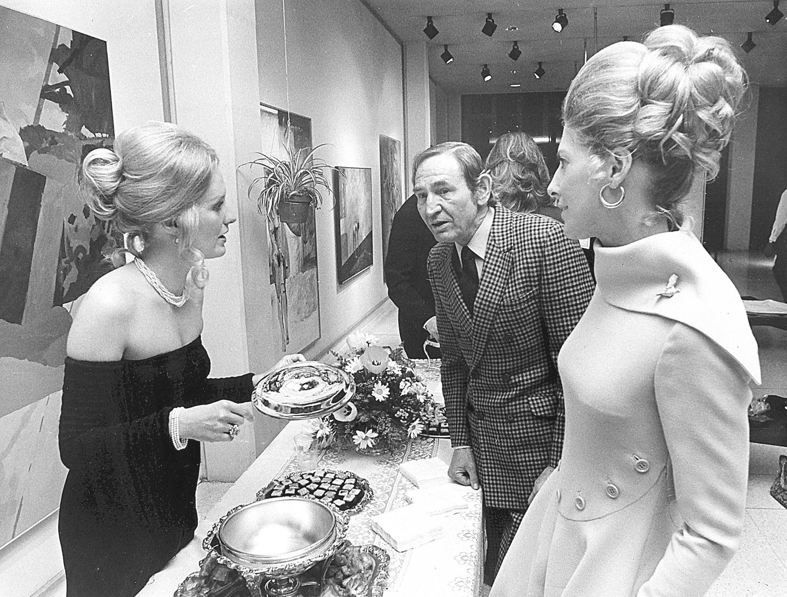 Rhea Looney (Left) plays hostess to noted artist Carroll Cloar and Mrs. Allison Kimball on 24 Mar 1972 at a slide showing of the artist's work at Memphis Academy of Arts. Cloar was commentator for the showing to benefit the Memphis Ballet Company.