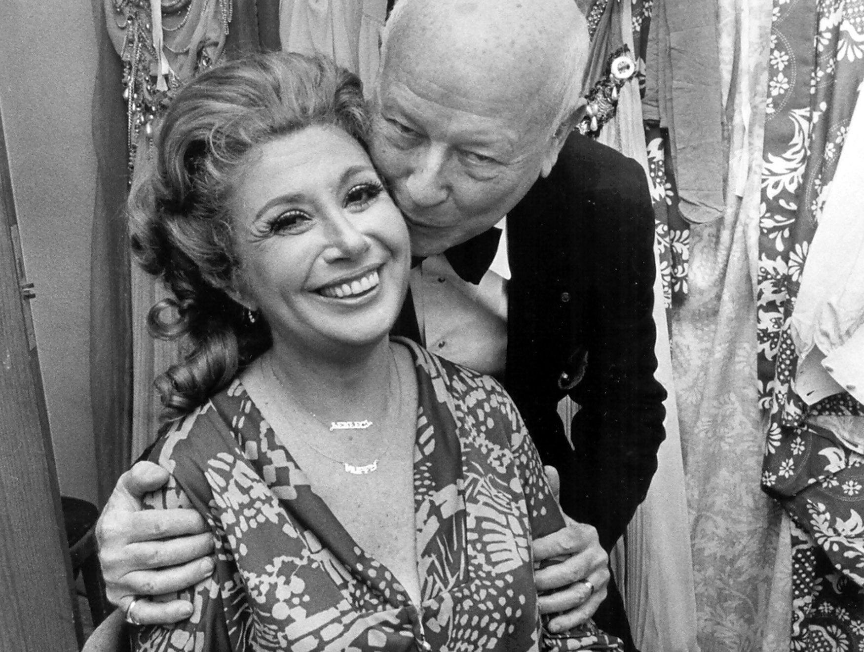 """Beverly Sills receives well wishes, along with kisses and cards from Francis Robinson, director of the Metropolitan Opera Tour at The Auditorium's Dixon-Myers Hall in May 1978. Miss Sills sang the title role in Massenet's """"Thais."""""""