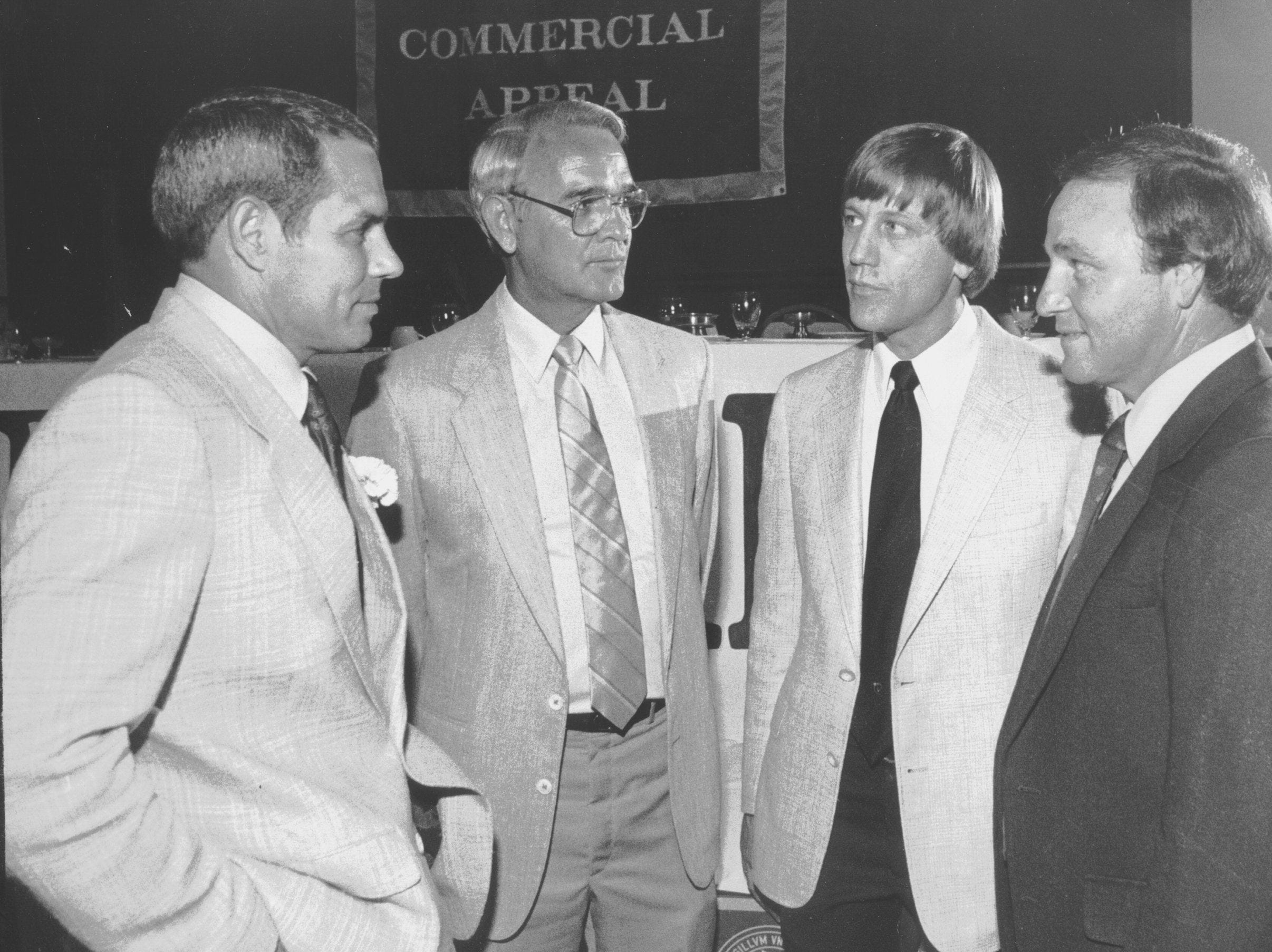"Ken Hatfield (Left), head football coach at the University of Arkansas, speaks with (From Left) Ken Netherland, of Class ""AAA"" Germantown High School, Danny Mathis of Class ""AA"" Kirby High School and Jimmy Heinz of Class ""A"" Evangelical Christian School at the Best of The Preps awards banquet on 14 May 1984. Hatfield was the featured speaker and the other coaches were named Male Sports Coach of the Year in their respective divisions."