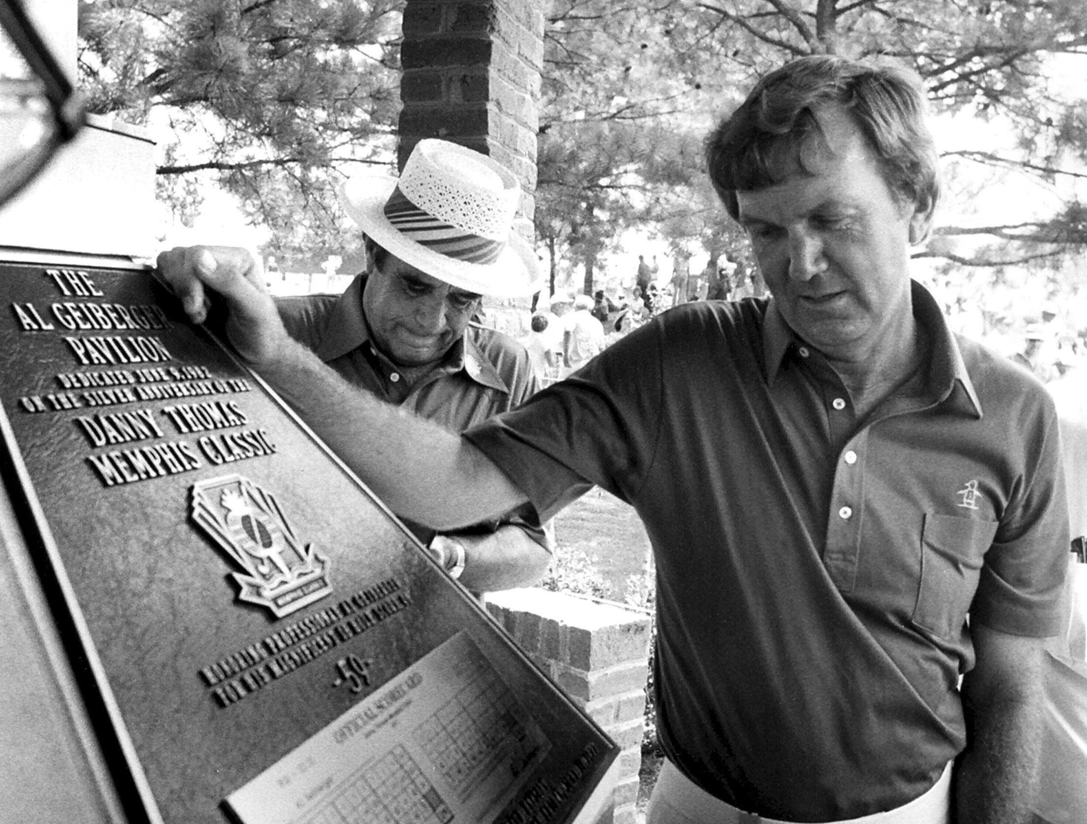Professional golfer Al Geiberger looks over the plaque placed in the pavilion named in his honor at Colonial Country Club on 9 June 1982. The pavilion was dedicated on the Silver Anniversary of the Danny Thomas Memphis Classic. Geiberger's record low round of 59 was accomplished during the 1977 tournament.