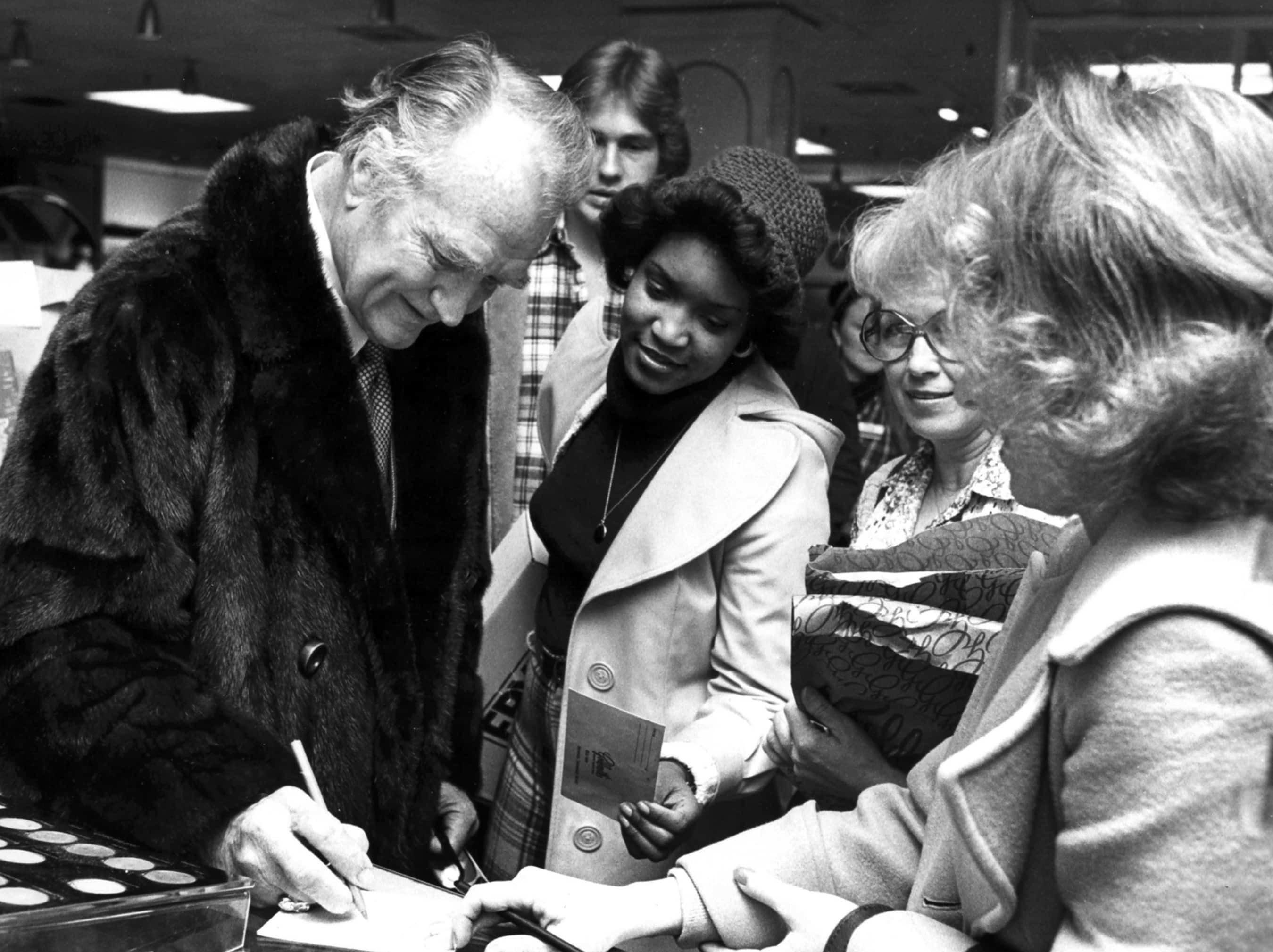 """February 7, 1979 - Red Skelton signs autographs for fans during a surprise appearance at Southland Mall on Feb. 7, 1979. He was at the mall to """"meet the people,"""" pose for photographs and do a little shopping. The 65-year-old comedian was in town for a performance at The Auditorium Dixon-Myers Hall."""