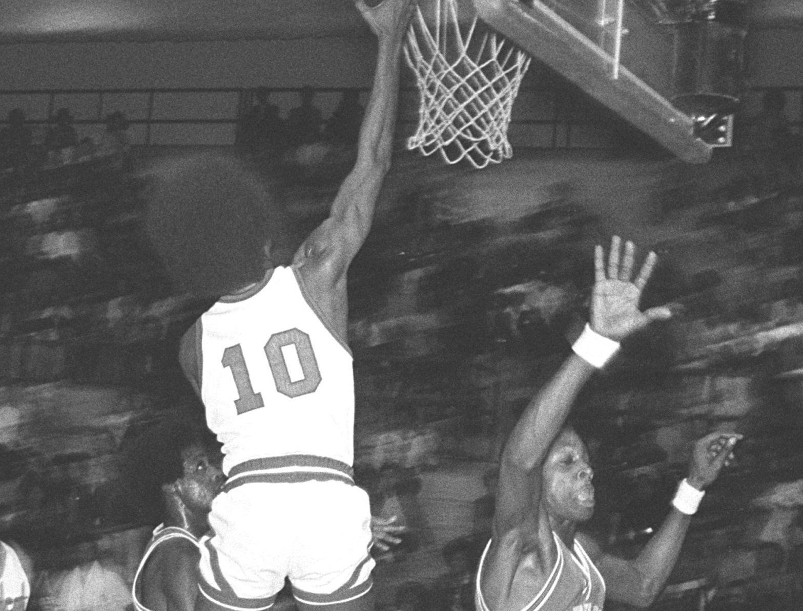 Hamilton's Eugene Pigues (10) gets a layup against Northside defenders in January 1975. Northside had four players in double figures and the Cougars made Hamilton their 19th victim of the season with a 94 to 70 win. Hamilton fell to 13-5.