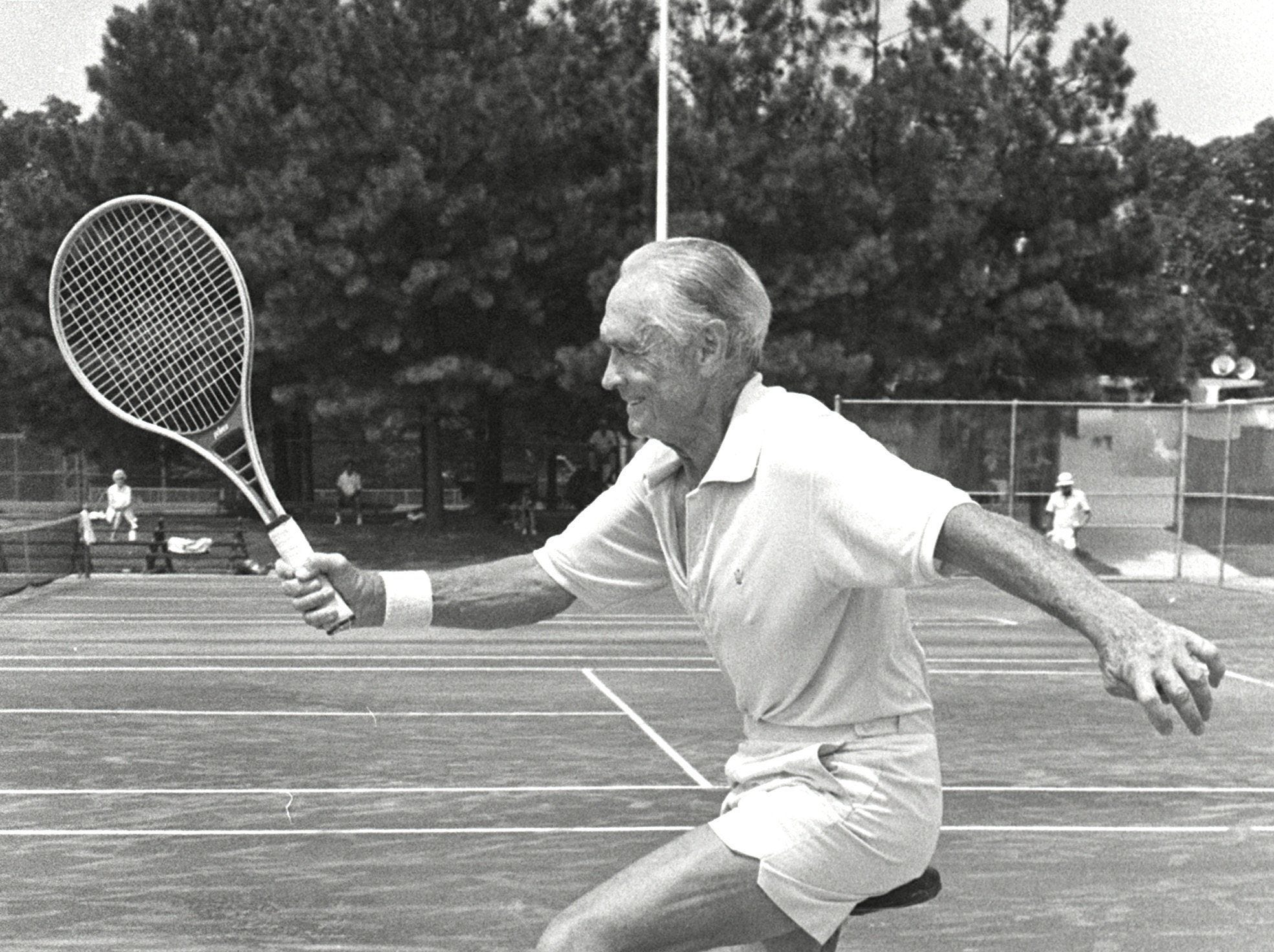 Paul W. Jones, 68, of Birmingham, Ala., likes to warm up for his tennis matches by riding a unicycle. Jones is competing in the Mississippi Valley Adult Tennis Tournament during August 1979.