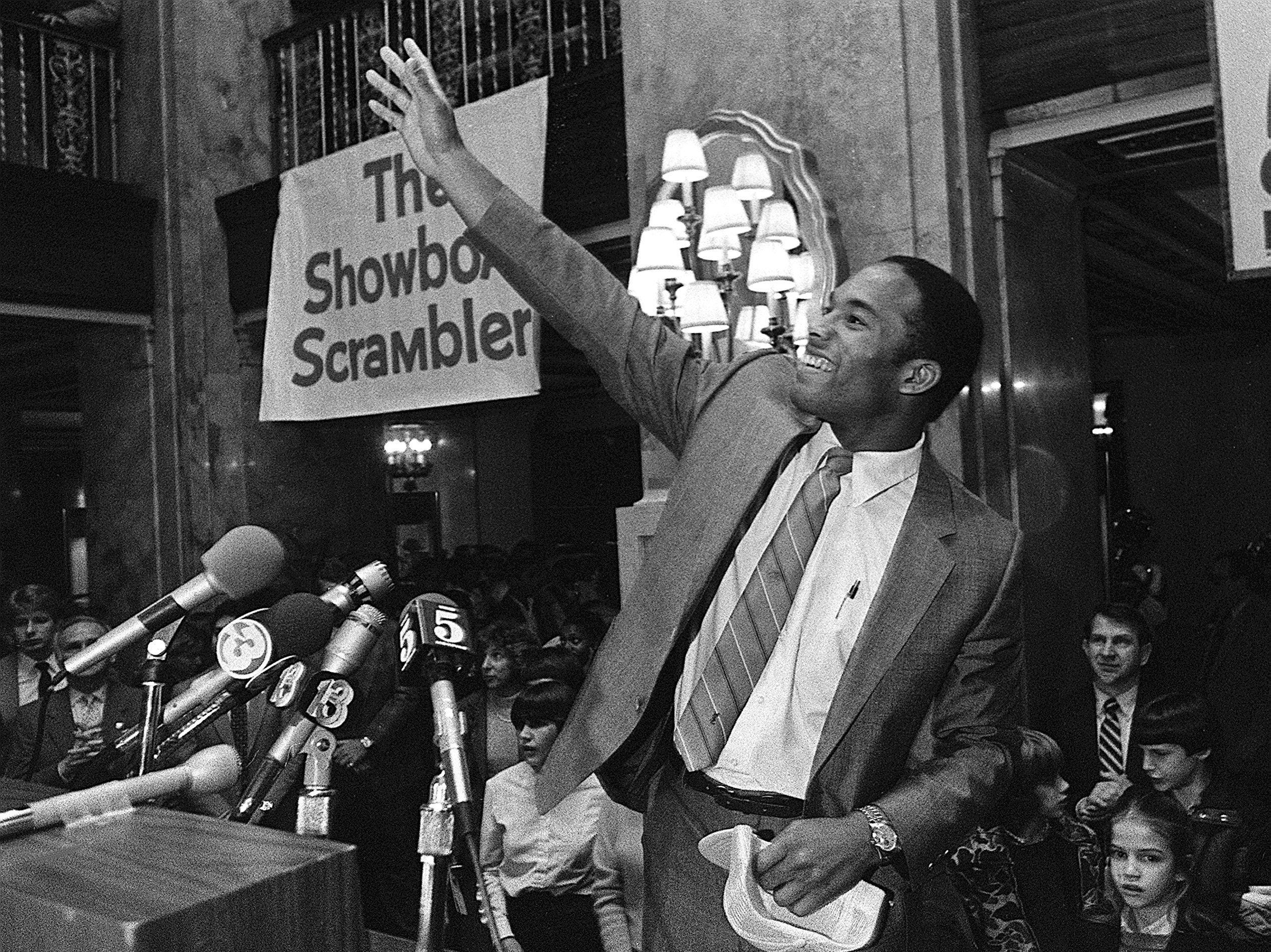 Former University of Alabama quarterback Walter Lewis waves to fans after being introduced as the newest member of the Memphis Showboats in February 1984. Lewis, who signed a three-year contract worth $1 million with a $400,000 signing bonus, was introduced to about 400 fans at a press conference in the lobby of The Peabody..