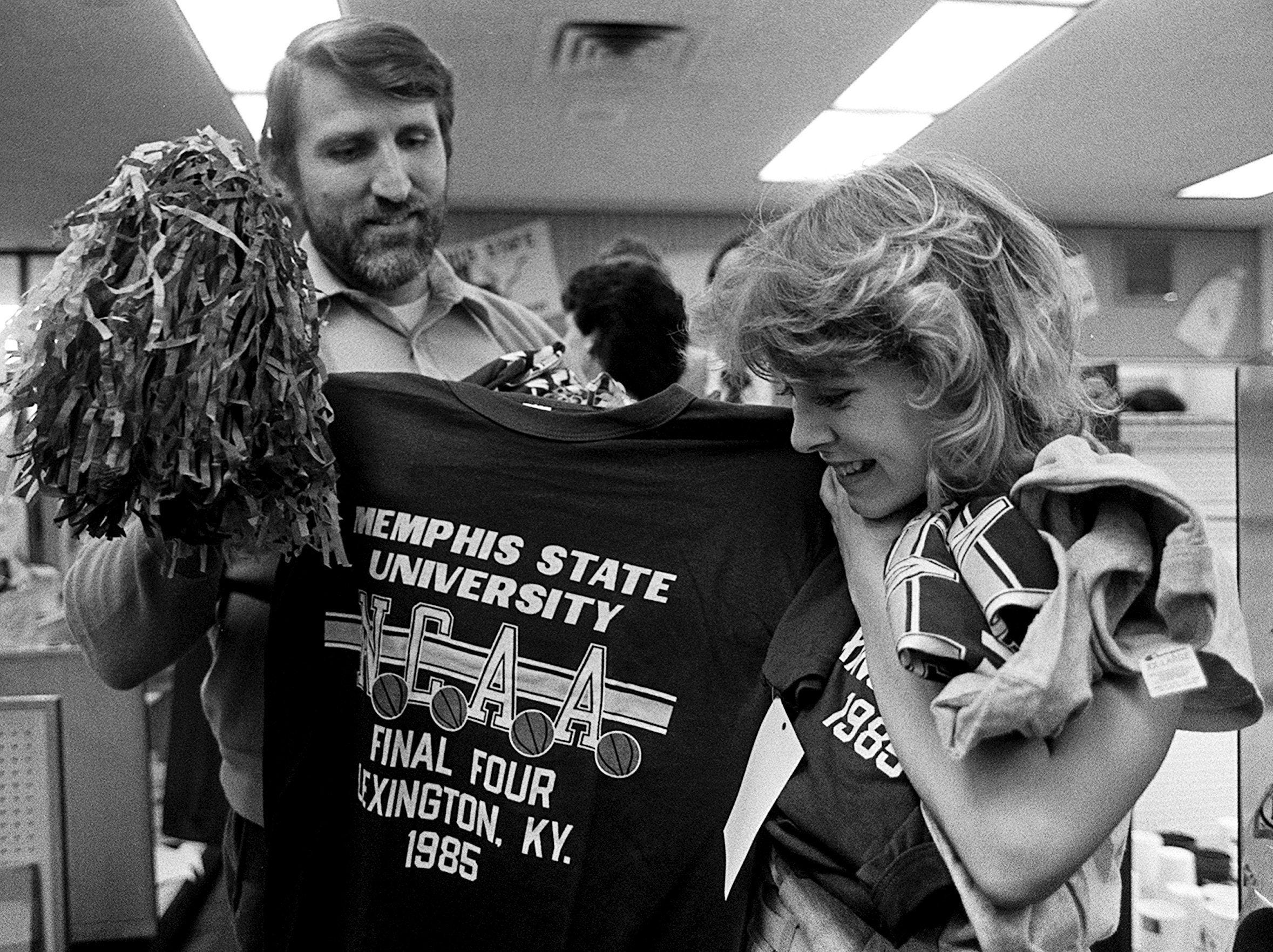 Jim Wessenauer and his daughter Dawn, 14, purchase Final Four T-shirts and pompons from MSU's bookstore on 26 Mar 1985 as the Tigers return to the Final Four.