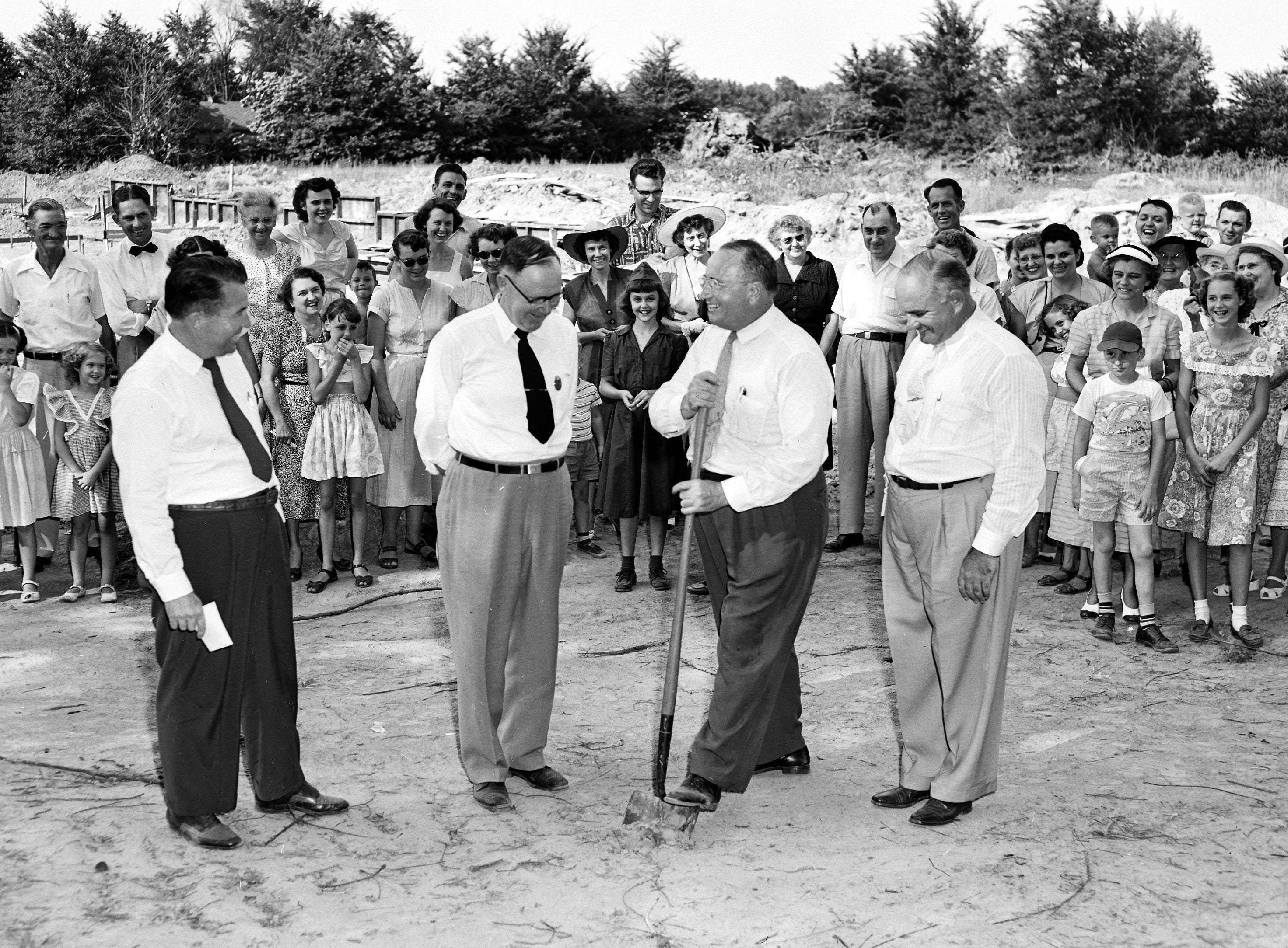 Future students were among the watchers as Seventh-Day Adventist leaders broke ground in July 1953 for the erection of a denominational Memphis Junior Academy on Mendenhall north of Walnut Grove. Making the dirt fly were (From Left) Teddrick Mohr of Nashville, educational secretary of the church's Kentucky-Tennessee Conference; Elder W.E. Strickland of Nashville, conference president; Elder E.E. Carman, pastor of First and Raleigh Seventh-Day congregations and Myron Harvey of Nashville, conference secretary-treasurer.