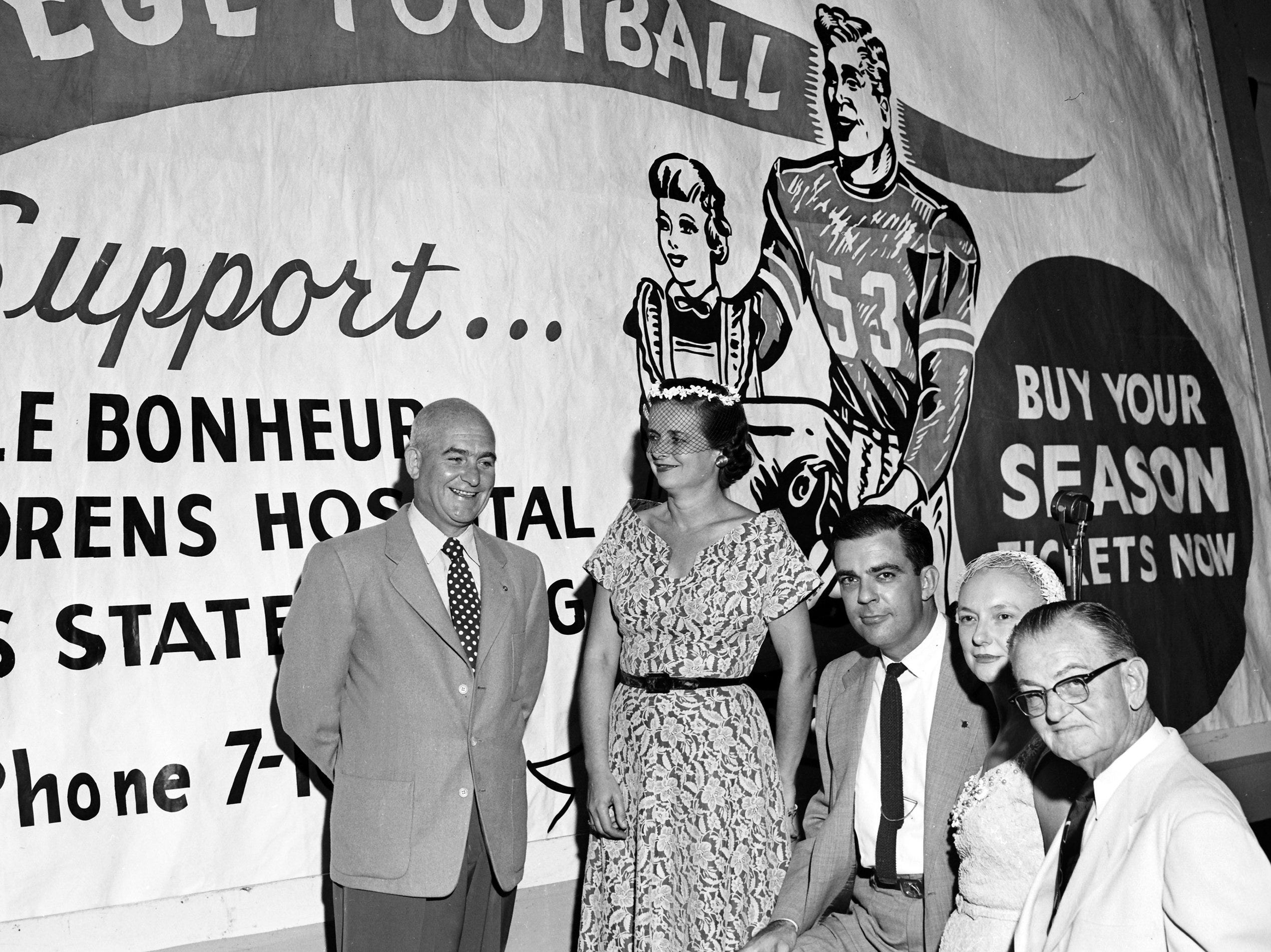 Memphis State enthusiasts dined on 1 Sep 1953 and talked up season ticket sales for the forthcoming football season, pledging to intensify their sales campaign in the remaining two weeks.  Leaders were (From Left) Dick Trippeer, member of the advisory committee of Greater Memphis State, Inc.; Mrs. Jerry Porter, sales chairman for Le Bonheur; Thomas E. Samuels, president of Greater Memphis State; Mrs. Frank M. Weathersby, president of Le Bonheur and Lee McCourt, advisory committeeman.
