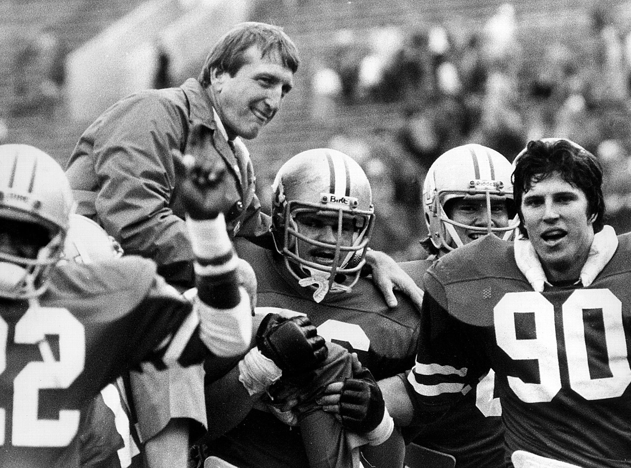 Memphis State head football coach Richard Williamson gets a ride on the shoulders of his Tiger players on Nov. 22, 1980, after beating Wichita State 6-0 to close out Williamson's stint as head coach of the Tigers. It was the 10th straight time the Tigers had beaten the Shockers. The Tigers finished the season with two wins and nine losses. Williamson finished with a 31-35 record as the Tigers' head coach. 10,069 watched the game played at Liberty Bowl Memorial Stadium.