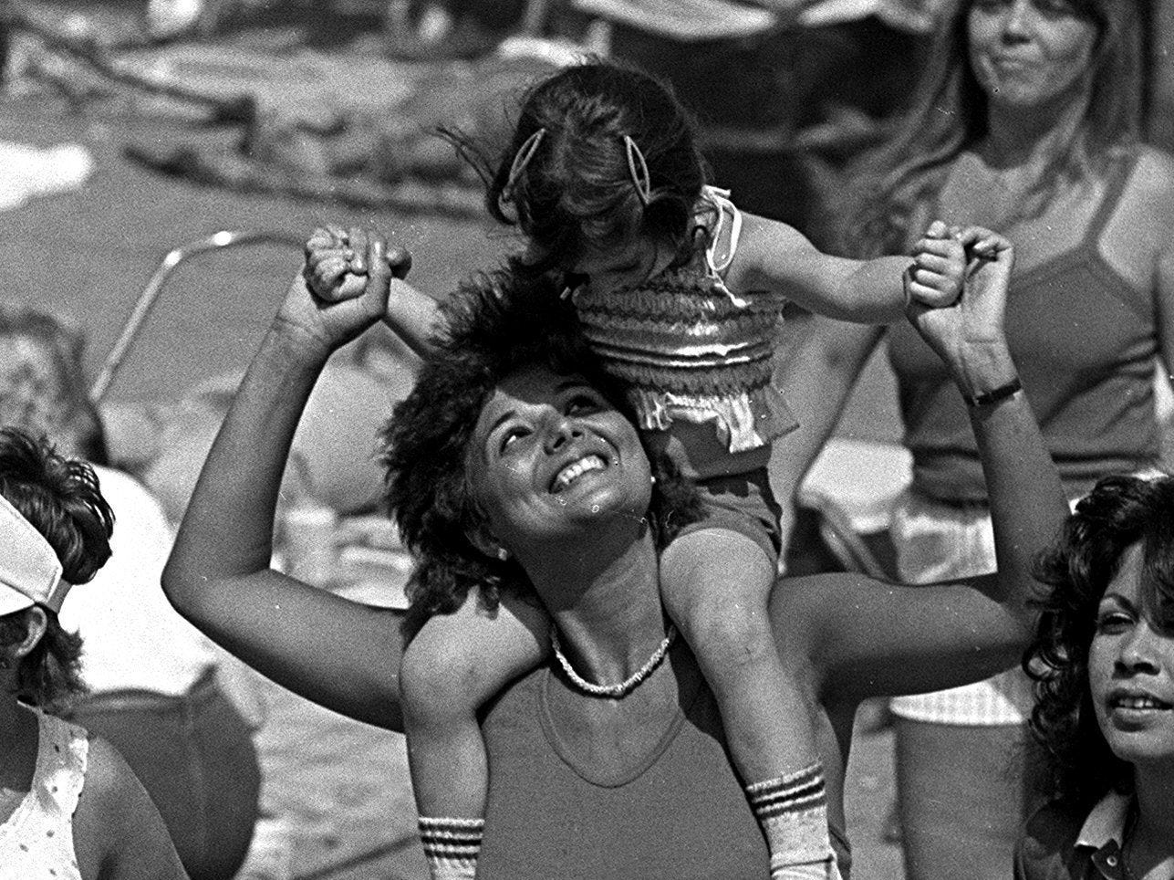 Sheila Fernandez dances with niece Stephanie Dunnavant, 3, in Tom Lee Park during the Independence Day celebration on 4 July 1984.