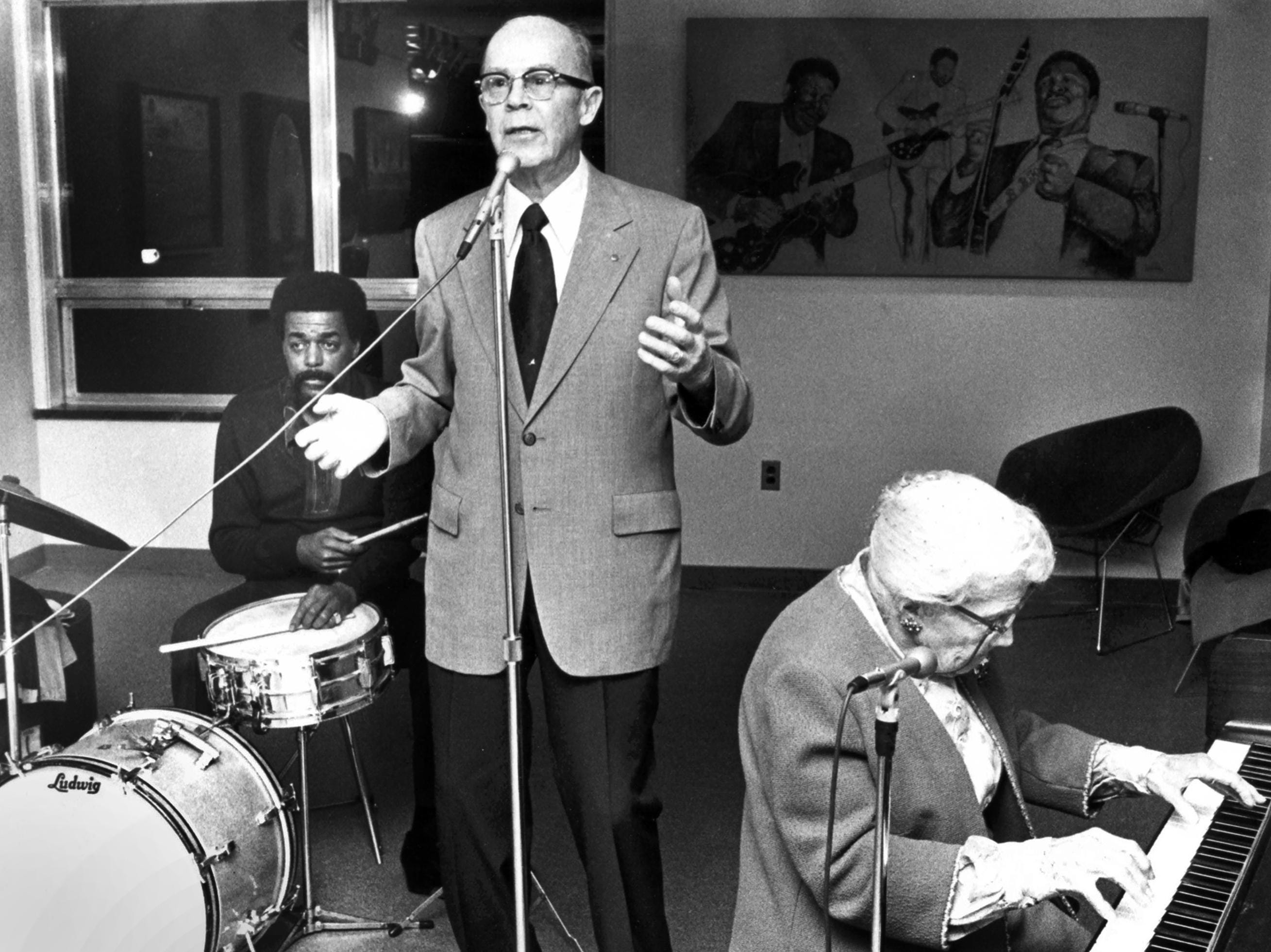 """February 12, 1979 - Harry Godwin (center) introduces Jeff Greer (left) on drums and Lillian """"Grandma Dixie"""" Davis, 82, on piano to an audience of about 50 people at the Public Library and Information Center at Peabody and McLean on Feb. 12, 1979. Miss Davis, who began playing the piano at age eight, thrilled the crowd with blues and ragtime numbers."""