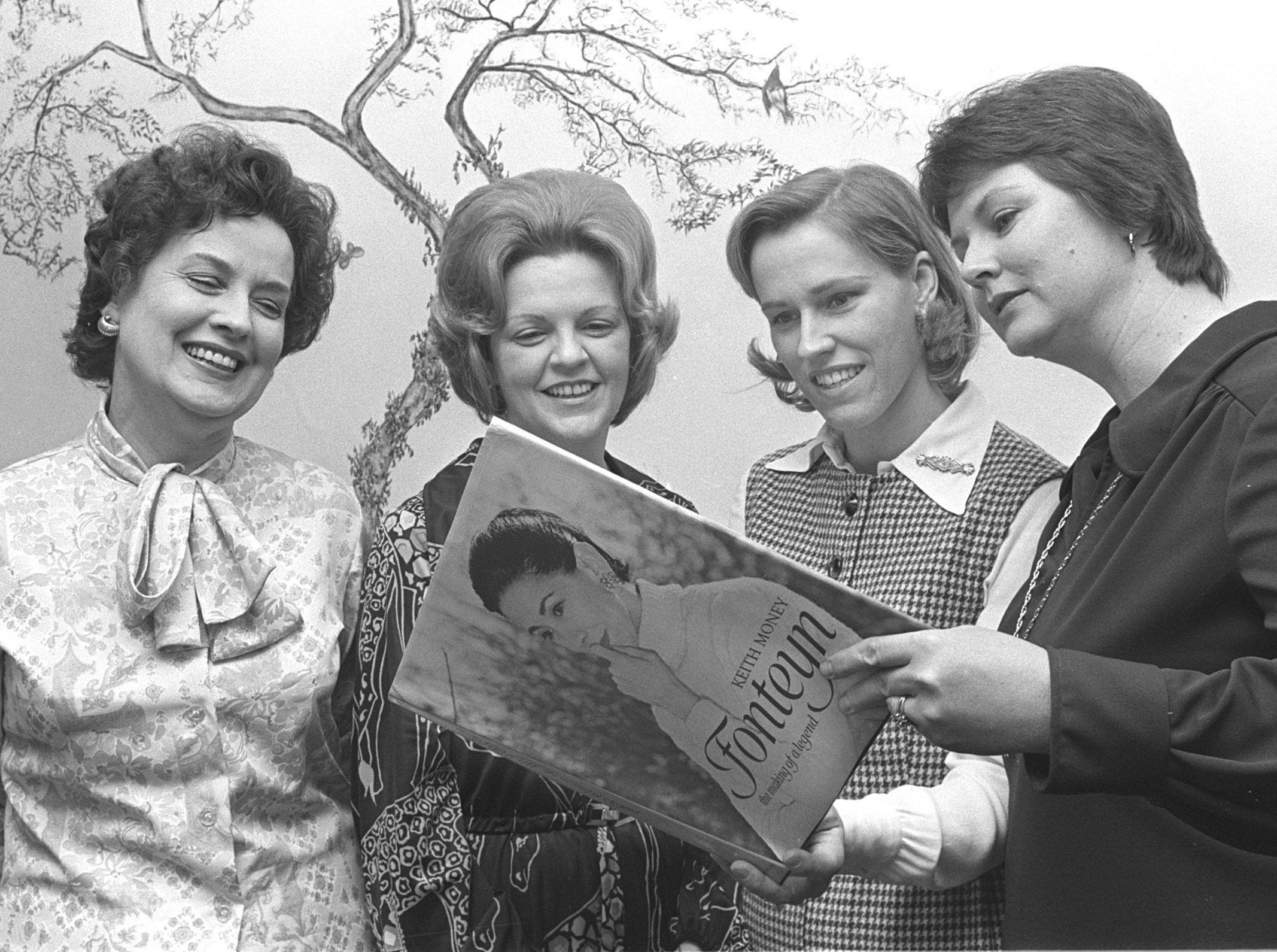 New members of the Ballet Guild were honored at a coffee in January 1975 at the home of the president, Mrs. Winfred Sharp (Left). The honorees include Mrs. John Wright (Second Left) and Mrs. William Parr Jr. (Second Right). Mrs. William F. (Right) Dietrich is president-elect.