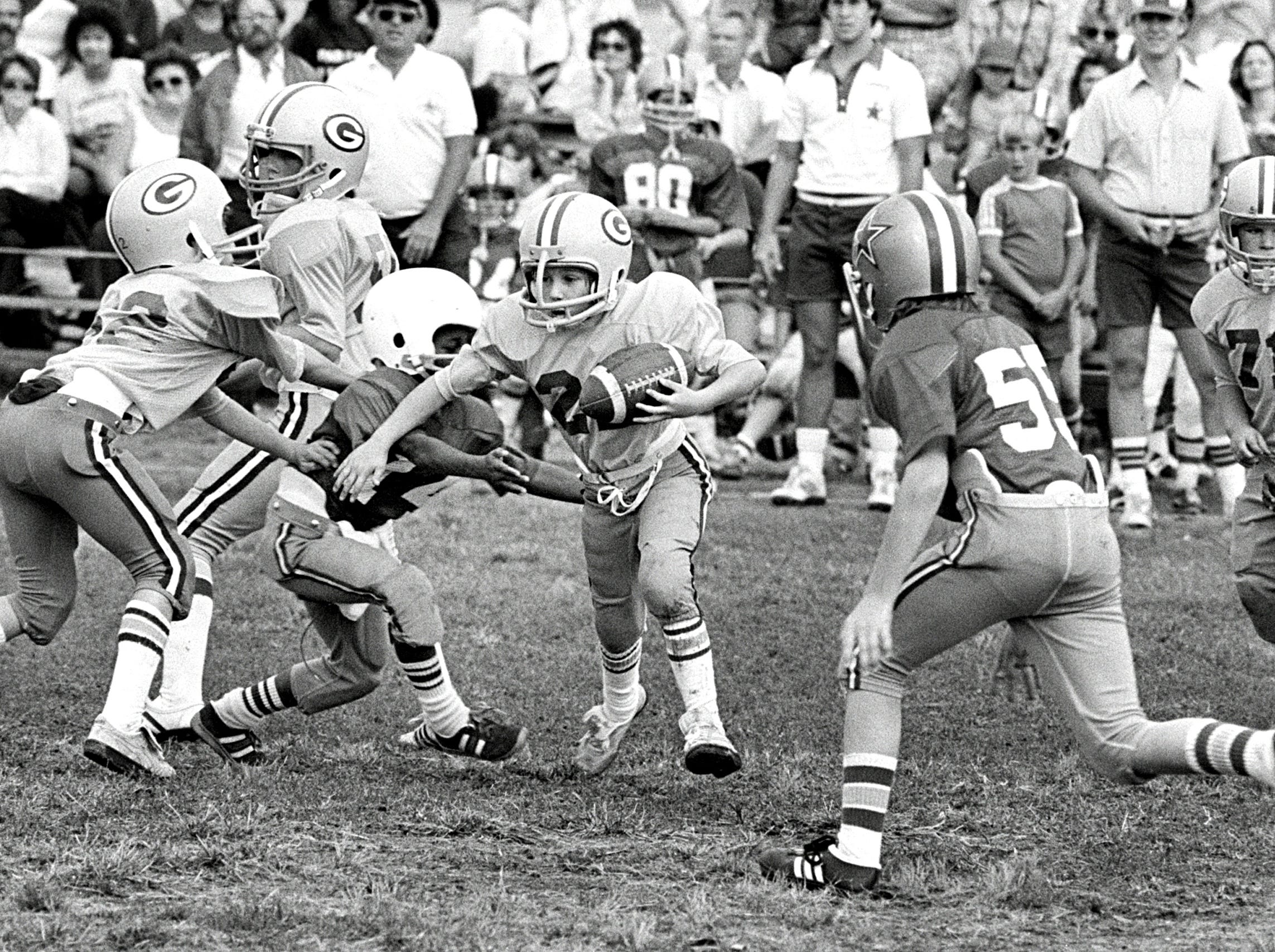 October 10, 1982 - Chris Parrish of the Packers tries to elude Cowboys tacklers on the gridiron at Knight Road Elementary School on October 10, 1982. These Southeast Memphis youngsters are filling a football void on Sundays while the National Football League is on strike. The Packers lost to the Cowboys 14 to 2 in this event, which was part of a doubleheader.